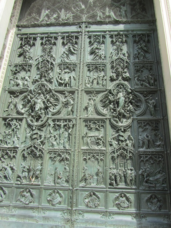 One of the 5 doors along the front of Milano Duomo, Italy