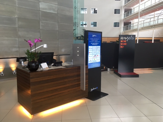 One of the reception desks at Radisson Blu London Stansted Airport Hotel