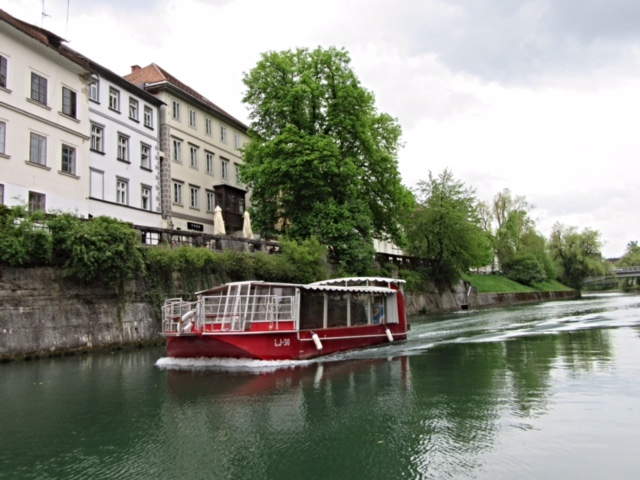 The Ljubljanica River trip on a wooden boat