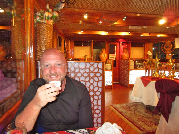 Mr ESLT enjoying the welcome coffee on the Dhow Dinner Cruise