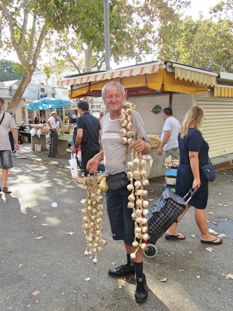 Man selling garlic at the Farmer's Market in Split, Croatia