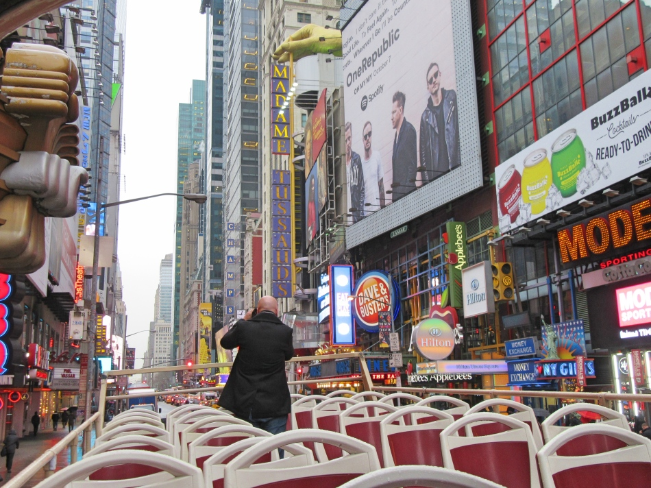 Mr ESLT snapping on Big Bus Tours New York