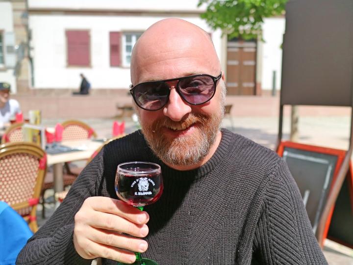 Mr ESLT drinking wine in Strasbourg, France