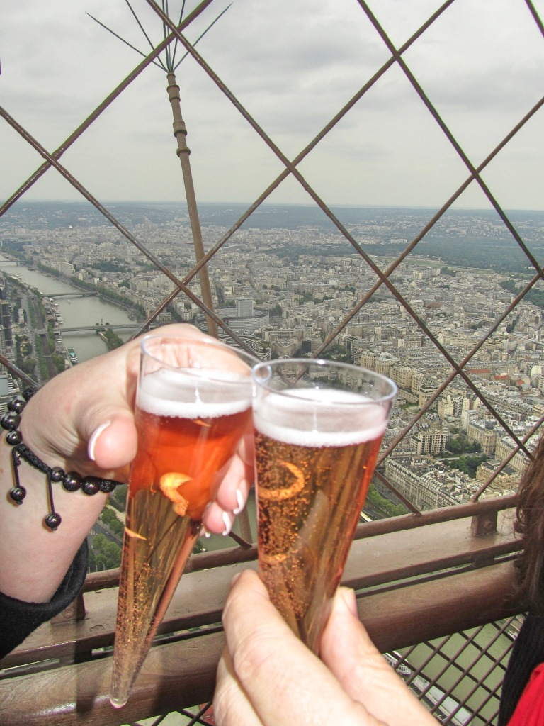 Cheers at the top of the Eiffel Tower, Paris, France